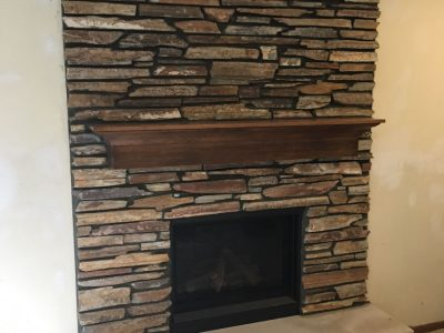 large limestone hearth fireplace installation mn