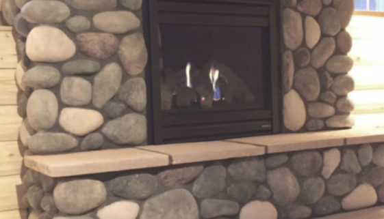 cabin living boulder fireplace