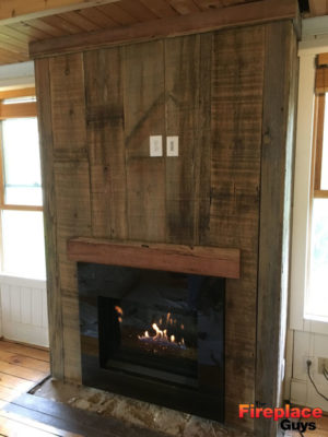 modern rustic fireplace after barnwood mantel