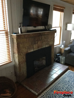 modern rustic fireplace before barnwood mantel